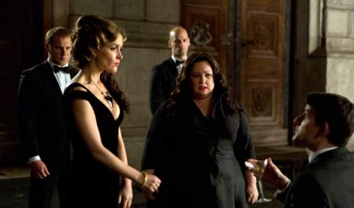 "This photo provided by Twentieth Century Fox shows, Melissa McCarthy, second right, infiltrating an arms dealing ring led by Rose Byrne, left, in a scene from the film, ""Spy."" (Larry Horricks/Twentieth Century Fox via AP)"