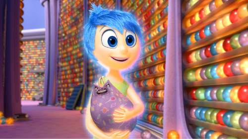 "In this image released by Disney-Pixar, the character Joy, voiced by Amy Poehler, appears in a scene from ""Inside Out,"" in theaters on June 19. (Disney-Pixar via AP)"
