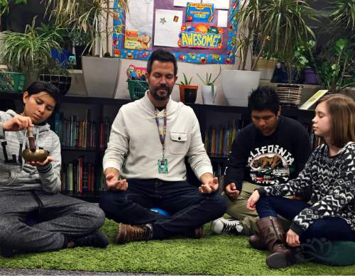 Jason Tackett, special-education teacher at Frankiln Elementary School in Salt Lake City, practices mindful meditation with students.  Courtesy of Jason Tackett