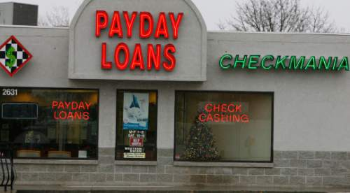 Leah Hogsten  | Tribune file photo  New state data show the average interest rate on a payday loan in Utah was 482 percent. Also, more than 45,000 Utahns hadn't paid off loans after 10 weeks.