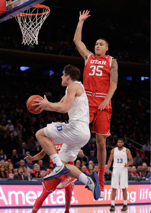 Duke guard Grayson Allen (3) attempts a reverse layup against Utah  forward Kyle Kuzma (35) during the first half of an NCAA college basketball game, Saturday, Dec. 19, 2015, in New York. (AP Photo/Julie Jacobson)