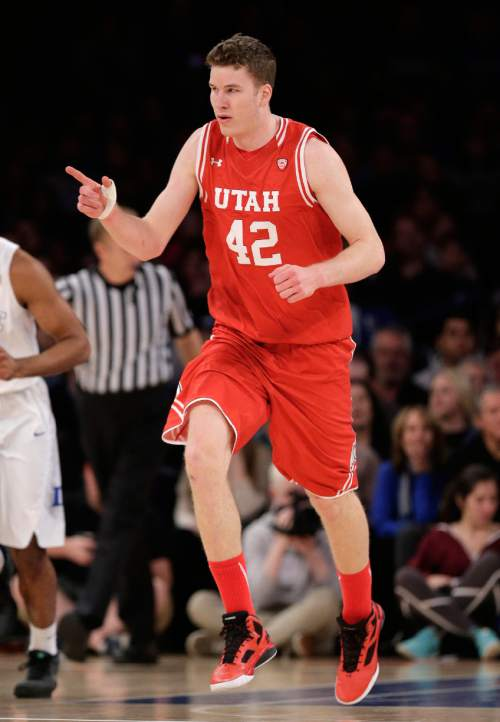 Utah forward Jakob Poeltl (42) points to a teammate after scoring against Duke in the first half of an NCAA college basketball game, Saturday, Dec. 19, 2015, in New York. Utah won 77-75 in overtime. (AP Photo/Julie Jacobson)