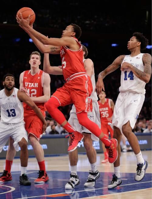 Utah guard Lorenzo Bonam (15) puts up a shot against Duke during the second half of an NCAA college basketball game, Saturday, Dec. 19, 2015, in New York. Utah won 77-75. (AP Photo/Julie Jacobson)