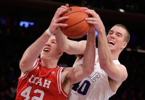 Utah forward Jakob Poeltl (42) and Duke center Marshall Plumlee (40) battle for a rebound during the second half of an NCAA college basketball game, Saturday, Dec. 19, 2015, in New York. Utah won 77-75 in overtime. (AP Photo/Julie Jacobson)