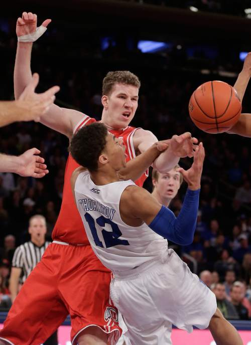 Utah forward Jakob Poeltl, left, fights for a rebound against Duke guard Derryck Thornton (12) during the second half of an NCAA college basketball game, Saturday, Dec. 19, 2015, in New York.  Utah won 77-75.(AP Photo/Julie Jacobson)