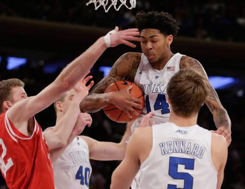 Duke guard Brandon Ingram (14) grabs a rebound against Utah during the second half of an NCAA college basketball game, Saturday, Dec. 19, 2015, in New York. (AP Photo/Julie Jacobson)