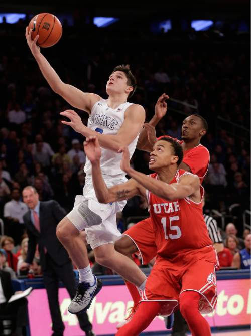 Duke guard Grayson Allen (3) goes up for a shot against Utah guard Lorenzo Bonam (15) during the first half of an NCAA college basketball game, Saturday, Dec. 19, 2015, in New York. (AP Photo/Julie Jacobson)