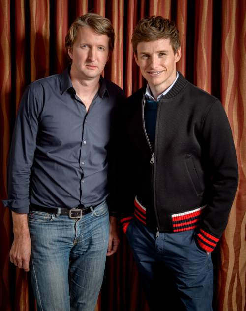 """FILE - In this Oct. 25, 2015 file photo, British director Tom Hooper, left, and British actor Eddie Redmayne pose for a portrait in promotion for """"The Danish Girl"""" in London. (Photo by Jonathan Short/Invision/AP, File)"""
