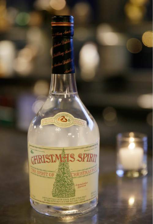 This Tuesday, Nov. 17, 2015, photo, shows a bottle of Christmas Spirit, the spirit of Christmas past, at the Gotham Club in San Francisco. The white whiskey is released by the Anchor Distilling Co. (AP Photo/Eric Risberg)