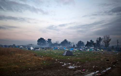 In this Saturday, Dec. 5, 2015 photo, tents of stranded migrants at the Greek-Macedonian border, as Qasu's family, a Yazidi refugee family from Sinjar, Iraq, are waiting near to be permitted to cross the border to Macedonia, near the northern Greek village of Idomeni. Within two days  the Qasus had traveled by midnight ferry from Lesbos to Athens and then by bus to Greece's northern border with Macedonia. (AP Photo/Muhammed Muheisen)