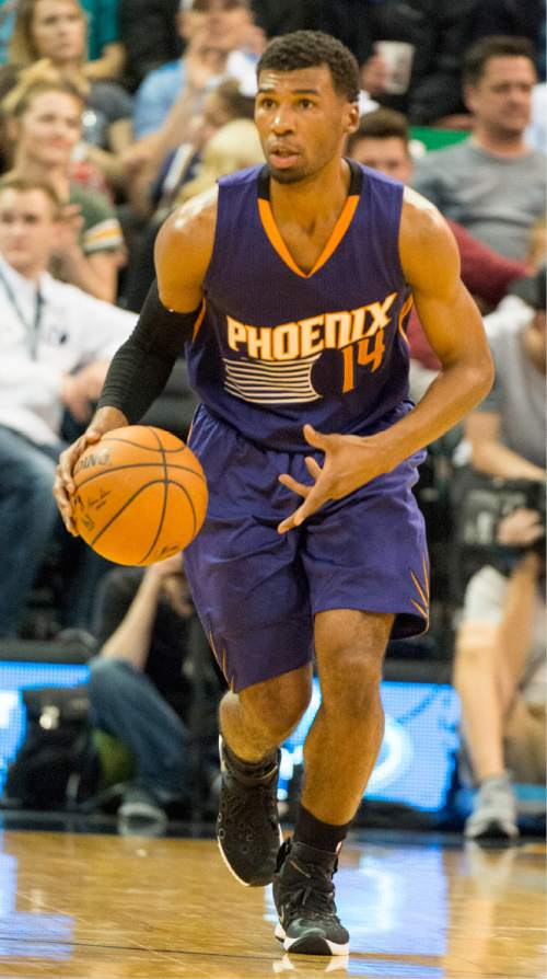 Rick Egan  |  The Salt Lake Tribune  Phoenix Suns guard Ronnie Price (14) brings the ball down court, in NBA action Phoenix Suns vs. The Utah Jazz, in Salt Lake City, Monday, December 21, 2015.