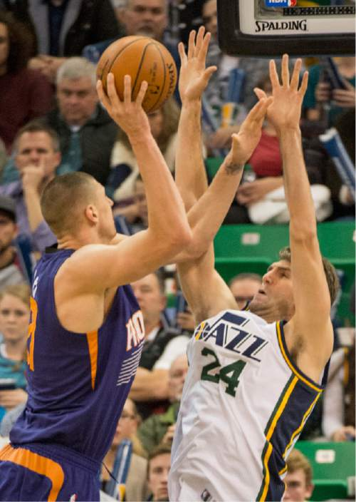 Rick Egan  |  The Salt Lake Tribune  Phoenix Suns center Alex Len (21) shoots overUtah Jazz center Jeff Withey (24), in NBA action Phoenix Suns vs. The Utah Jazz, in Salt Lake City, Monday, December 21, 2015.