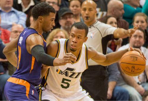 Rick Egan  |  The Salt Lake Tribune  Utah Jazz guard Rodney Hood (5) tries to work the ball inside, as Phoenix Suns guard Ronnie Price (14) defends, in NBA action Phoenix Suns vs. The Utah Jazz, in Salt Lake City, Monday, December 21, 2015.