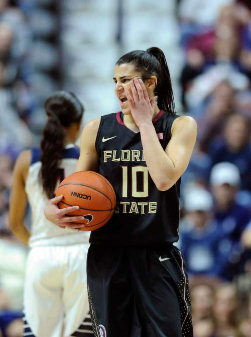 In this Dec. 11, 2015 photo, Florida State's Leticia Romero reacts to being fouled during an NCAA college basketball game against Connecticut in Uncasville, Conn. Romero is one of 275 international players competing this season in women's Division I basketball. Nearly 50 different countries are represented, including Russia, Spain, Australia, Brazil, Senegal, Canada and China. (AP Photo/Fred Beckham)