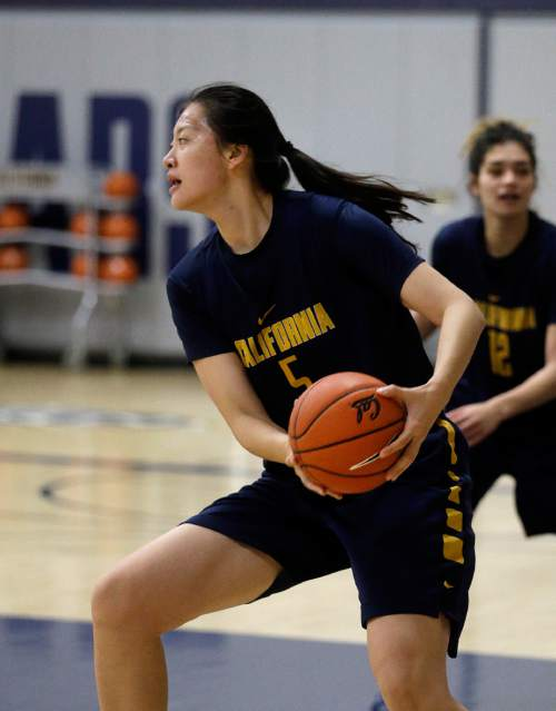 In this Dec. 12, 2015 photo, California's Chen Yue looks to pass during a team workout in Berkeley, Calif. The 6-foot-7 freshman center, who is believed to be one of the first Chinese basketball players to play at a high college level, says she came to the U.S. to challenge herself both on the court and in the classroom. (AP Photo/Ben Margot)