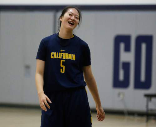 In this Dec. 12, 2015 photo, California's Chen Yue of Beijing laughs during a team workout in Berkeley, Calif. The 6-foot-7 freshman center, who is believed to be one of the first Chinese basketball players to play at a high college level, wanted to challenge herself both on the court and in the classroom. So heading to the U.S. was an easy decision. (AP Photo/Ben Margot)