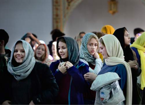 """Scott Sommerdorf      The Salt Lake Tribune Students from Corner Canyon High School leave after a visit with Imam Muhammed S Mehtar. They listened to him speak about the hijab and its meaning in Islamic culture prior to a news conference at the Khadeeja Islamic Center in West Valley City, Thursday, December 17, 2015. Noor Ul-Hasan later introduced invited guests and other interfaith reps who joined together to announce """"Wear a Hijab"""" and other headgear on Friday as a show of support for Muslims."""