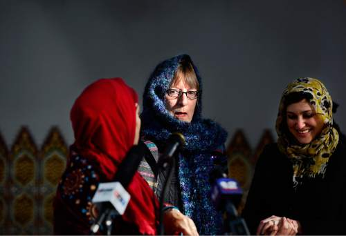 """Scott Sommerdorf      The Salt Lake Tribune The Rev. Mary S. Janda ~ Vicar at West Valley Episcopal, center, speaks with Noor Ul-Hasan, left, and Rabbi Ilana Schwartzman, right, after a press conference at Khadeeje Islamic Center in West Valley City, Thursday, December 17, 2015. Invited guests and other interfaith reps joined together to announce """"Wear a Hijab"""" and other headgear on Friday as a show of support for Muslims."""