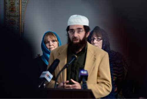 """Scott Sommerdorf      The Salt Lake Tribune The Rev. Patty C. Willis, background left, of the Unitarian Church listens as Imam Muhammed S Mehtar speaks at a news conference at Khadeeja Islamic Center in West Valley City, Thursday, December 17, 2015. At right is the Rev. Mary S. Janda, vicar at St. Stephen's Episcopal Church in West Valley City. Noor Ul-Hasan and invited politicos and other interfaith reps joined together to announce """"Wear a Hijab"""" and other headgear on Friday as a show of support for Muslims."""