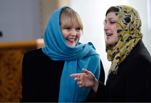 """Scott Sommerdorf      The Salt Lake Tribune The Rev. Patty C. Willis, left, of the Unitarian Church speaks with Rabbi Ilana Schwartzman of Salt Lake City's Jewish Congregation Kol Ami at a news conference at Khadeeja Islamic Center in West Valley City, Thursday, December 17, 2015. Noor Ul-Hasan and invited politicos and other interfaith reps joined together to announce """"Wear a Hijab"""" and other headgear on Friday as a show of support for Muslims."""