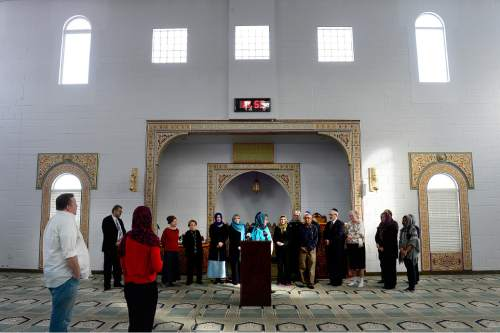 """Scott Sommerdorf      The Salt Lake Tribune A news conference at Khadeeja Islamic Center in West Valley City, Thursday, December 17, 2015. Noor Ul-Hasan and invited politicos and other interfaith reps joined together to announce """"Wear a Hijab"""" and other headgear on Friday as a show of support for Muslims."""