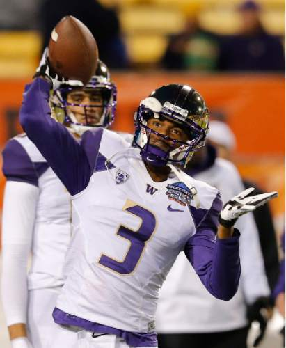 Washington quarterback Troy Williams (3) in the first half during the Cactus Bowl NCAA college football game against Oklahoma State, Friday, Jan. 2, 2015, in Tempe, Ariz. (AP Photo/Rick Scuteri)