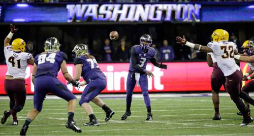 Washington quarterback Troy Williams (3) passes against Arizona State during the first half of an NCAA college football game Saturday, Oct. 25, 2014, in Seattle. (AP Photo/Elaine Thompson)