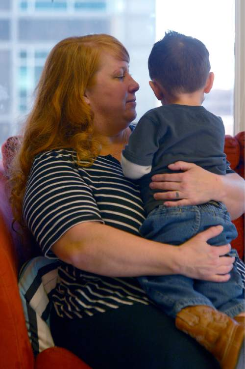 Leah Hogsten  |  The Salt Lake Tribune Nicki Bidlack holds her son, December 24, 2015. Bidlack and her son's biological mother who is her longtime partner, Sara Clow, died before they could formally marry, but secured what is believed to be the first recognition of a common law LGBT marriage from the 2nd District Court. The ruling allowed Bidlack to secure a new birth certificate for their son, which names both women as his parents.