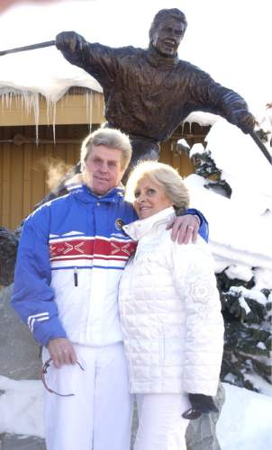 "Leah Hogsten | 2001 Tribune file photo . On Dec. 8, 2001, Olympian and world champion skier Stein Eriksen and his wife Francoise  pose next to the newly unveiled bronze statue of Eriksen titled ""Come Ski With Me."" A crowd gathered at the entrance of Snow Park Lodge to honor Eriksen, with then-Gov. Mike Leavitt  on hand to declare  ""Stein Eriksen Day."""