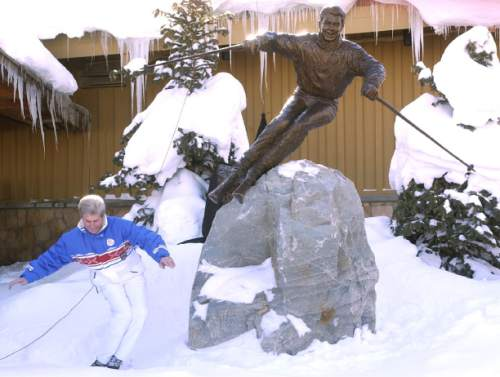 "Leah Hogsten | 2001 Tribune file photo . On Dec. 8, 2001, Olympian and world champion skier Stein Eriksen struck a skiing pose next to the newly unveiled bronze statue of himself titled ""Come Ski With Me."" A crowd gathered at the entrance of Snow Park Lodge to honor Eriksen, with then-Gov. Mike Leavitt  on hand to declare  ""Stein Eriksen Day."""