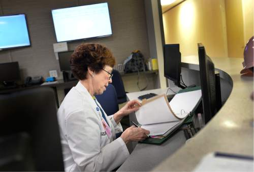Scott Sommerdorf   |  The Salt Lake Tribune Dr. Vicki L. Macy, MD, OBGYN, checks in at the nurse's station and files some paperwork after visiting with patients at Salt Lake Regional Medical Center, Wednesday, September 30, 2015.