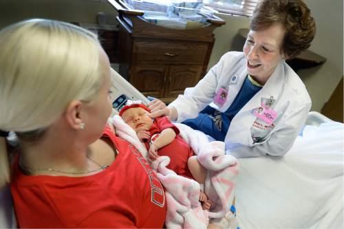 Scott Sommerdorf   |  The Salt Lake Tribune Dr. Vicki L. Macy, MD, OBGYN, checks on new mother Candace Horne holding her new daughter Brinley at Salt Lake Regional Medical Center, Wednesday, September 30, 2015.