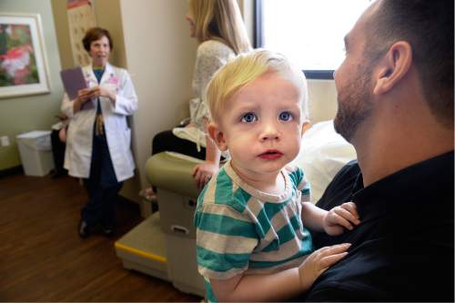 Scott Sommerdorf   |  The Salt Lake Tribune Two year old Ryan Wangsgard examines the camera lens as Dr. Vicki L. Macy, MD, OBGYN, speaks with Sarah Wangsgard and husband David, holding two year old Ryan at Salt Lake Regional Medical Center, Wednesday, September 30, 2015. Dr. Macy delivered the Wangsgard's son, Ryan.