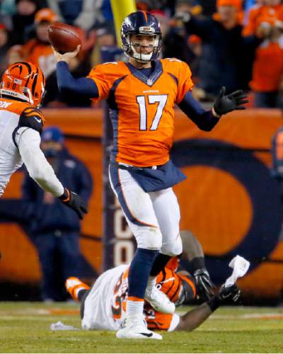Denver Broncos quarterback Brock Osweiler (17) throws against the Cincinnati Bengals during the second half of an NFL football game, Monday, Dec. 28, 2015, in Denver. (AP Photo/Joe Mahoney)