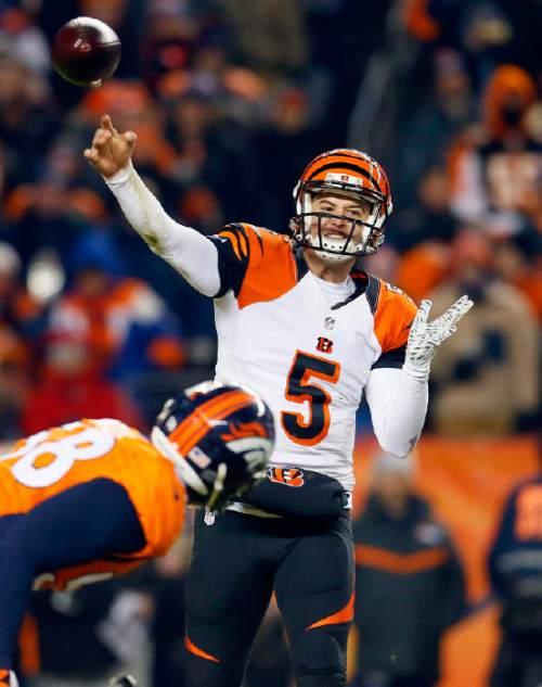 Cincinnati Bengals quarterback AJ McCarron (5) throws against the Denver Broncos during the second half of an NFL football game, Monday, Dec. 28, 2015, in Denver. (AP Photo/Joe Mahoney)
