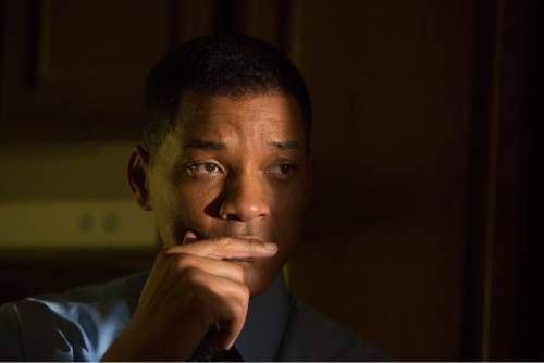 """This image released by Columbia Pictures shows Will Smith in a scene from the film, """"Concussion."""" Smith plays Dr. Bennet Omalu, a Nigerian-born forensic pathologist in Pittsburgh who knows nothing about football when he performs the autopsy on former Steelers center Mike Webster. Omalu discovers CTE in Webster's brain, setting him on a journey that exposes the concussion crisis. (Melinda Sue Gordon/Columbia Pictures via AP)"""