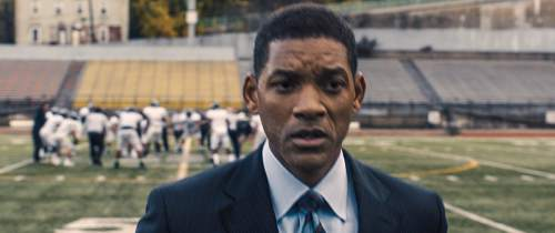 """This image released by Columbia Pictures shows Will Smith in a scene from the film, """"Concussion."""" Smith plays Dr. Bennet Omalu, a Nigerian-born forensic pathologist in Pittsburgh who knows nothing about football when he performs the autopsy on former Steelers center Mike Webster. Omalu discovers CTE in Webster's brain, setting him on a journey that exposes the concussion crisis. (Columbia Pictures via AP)"""