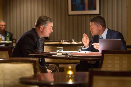 """This photo provided by Columbia Pictures shows, Alec Baldwin, from left, as Dr. Julian Bailes, and Will Smith as Dr. Bennet Omalu, in a scene from Columbia Pictures' """"Concussion."""" The movie releases in U.S. theaters on Dec. 25, 2015. (Melinda Sue Gordon/Columbia Pictures via AP)"""