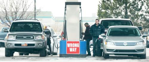 Steve Griffin     The Salt Lake Tribune   Motorists fill up their cars at the Costco gas station in Salt Lake City, Monday, December 28, 2015.