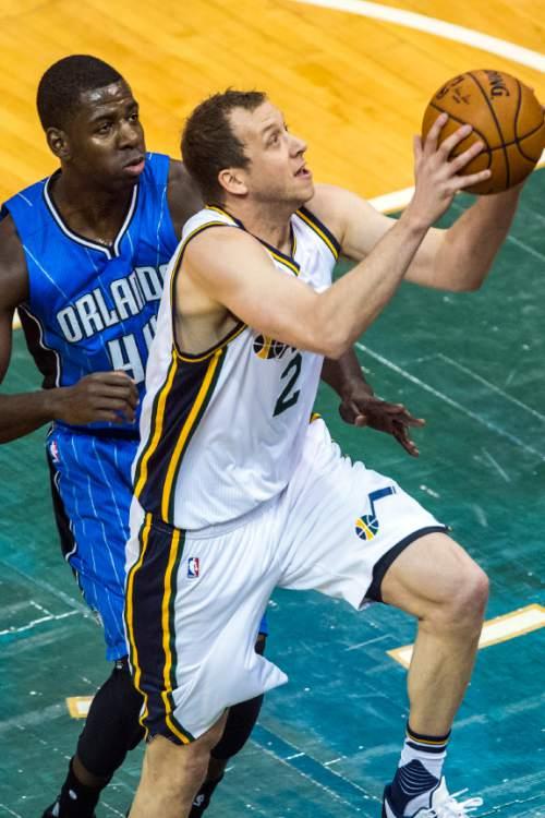 Chris Detrick  |  The Salt Lake Tribune Utah Jazz forward Joe Ingles (2) shoots past Orlando Magic forward Andrew Nicholson (44) during the game at Vivint Smart Home Arena Thursday December 3, 2015.
