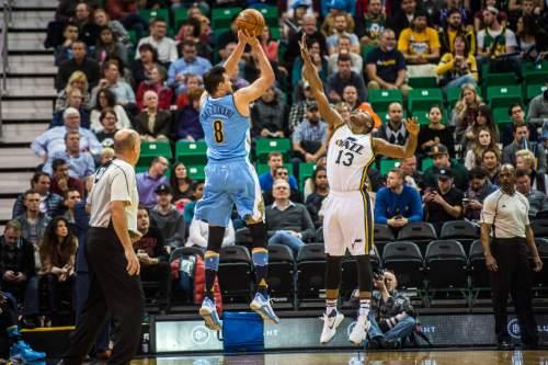 Chris Detrick  |  The Salt Lake Tribune Denver Nuggets forward Danilo Gallinari (8) shoots over Utah Jazz guard Elijah Millsap (13) during the game at Vivint Smart Home Arena Friday December 18, 2015.