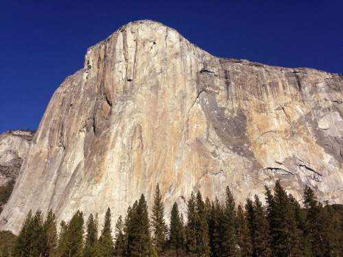 FILE - This Jan. 14, 2015, file photo, shows El Capitan in Yosemite National Park, Calif. Many of the country's most prominent national parks, including Grand Canyon, Yellowstone and Zion, set new visitation records in 2015. The National Park Service celebrates its 100th birthday in 2016 and has been urging Americans to rediscover the country's scenic wonders or find new parks to visit through marketing campaigns. (AP Photo/Ben Margot, File)