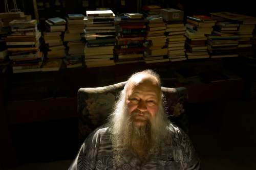 Tribune file photo Ken Sanders poses for a portrait in his book store in 2008.
