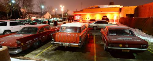 "Steve Griffin  |  The Salt Lake Tribune  A 1961 Chrysler 300G, a 1957 Chevrolet Nomad and a 1966 Ford Mustang glow in the parking lot light of the Red Iguana 2 restaurant as part America's Car Museum's ""The Drive Home,"" a vintage car road trip from Tacoma, Wash., to Detroit. The Museum is driving the vintage vehicles from the museum to the North American International Auto Show. The caravan arrived in Salt Lake City for a pit stop at a restaurant to mingle with local automotive and travel enthusiasts Tuesday, December 29, 2015."