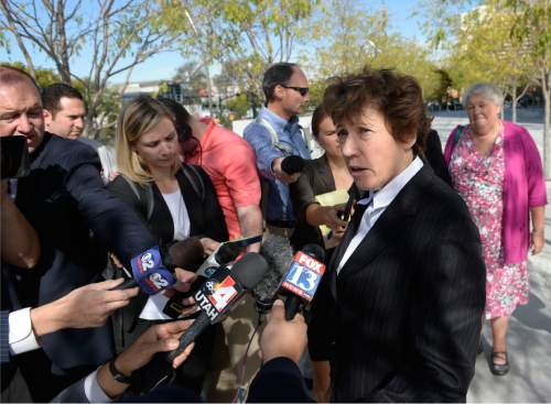 Al Hartmann  |  The Salt Lake Tribune Peggy Tomsic, attorney for Utah Planned Parenthood speaks to the media outside the Federal Court building in Salt Lake City after a hearing before U.S. District Judge Clark Waddoups Thursday October 15.  Behind at right is CEO Carrie Galloway CEO of Utah Planned Parenthood.  The family planning organization is suing Utah Governor Gary Herbert for cutting of its federal funding.