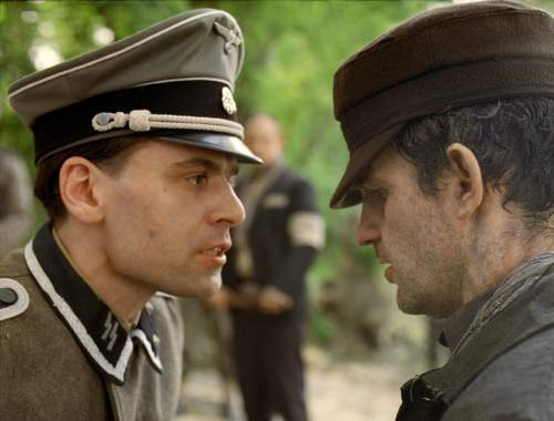 """This image released by Sony Pictures Classics shows Christian Harting, left, and Geza Rohrig in a scene from """"Son of Saul.""""  (Sony Pictures Classics via AP)"""
