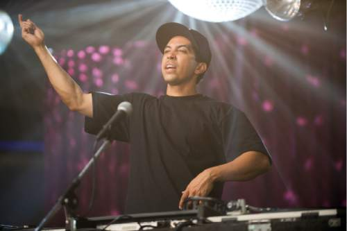 """This photo provided by Universal Pictures shows, Neil Brown, Jr., as DJ Yella, in a scene from the film, """"Straight Outta Compton."""" The movie releases in U.S. theaters on Aug. 14, 2015. (Jaimie Trueblood/Universal Pictures via AP)"""