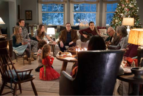 """This photo provided by CBS Films and Lionsgate shows, Amanda Seyfried, from left, as Ruby, Jake Lacy, as Joe, Olivia Wilde, as Eleanor, Maxwell Simkins, as Bo, Blake Baumgartner, as Madison, John Goodman, as Sam, Ed Helms, as Hank, Alan Arkin, as Bucky, Diane Keaton as Charlotte, and Alex Borstein (back to camera), in """"Love the Coopers,"""" released by CBS Films and Lionsgate. The movie opens in U.S. theaters on Nov. 13, 2015.  (Suzanne Tenner/CBS Films/Lionsgate via AP)"""