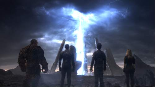 """This photo provided by courtesy Twentieth Century Fox shows, The Thing, from left, Michael B. Jordan as Johnny Storm, Miles Teller as Dr. Reed Richards, and Kate Mara as Sue Storm, in a scene from the film, """"Fantastic Four."""" The movie releases in U.S. theaters on Friday, Aug. 7, 2015. (Twentieth Century Fox via AP)"""