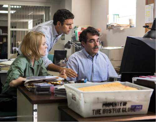 """This photo provided by courtesy of Open Road Films shows, Rachel McAdams, from left, as Sacha Pfeiffer, Mark Ruffalo as Michael Rezendes and Brian d'Arcy James as Matt Carroll, in a scene from the film, """"Spotlight."""" (Kerry Hayes/Open Road Films via AP)"""